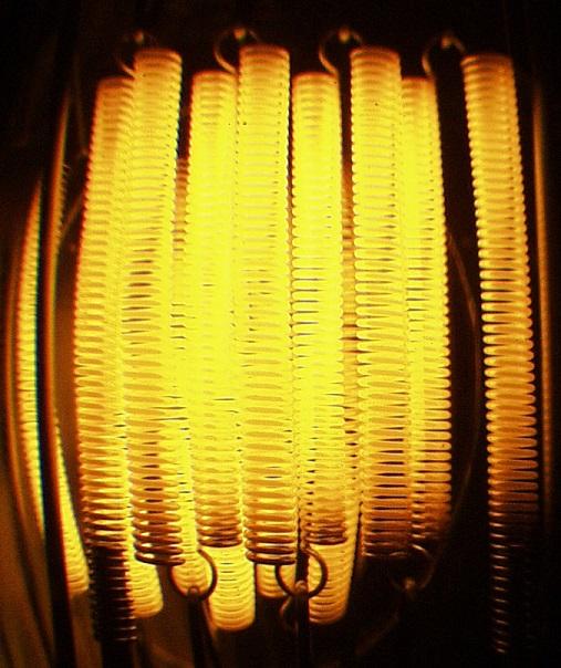 Glowing tungsten filament in a halogen lamp